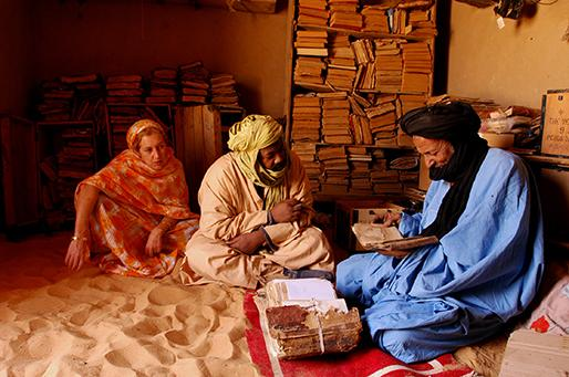 Stephanie Diakité, Abdel Kadel Haidara, and an elder from one of Mali's ancient manuscript-holding families. Image by Stephanie Diakité. Mali, 2013.