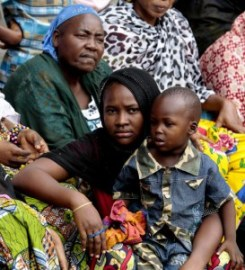 Women and children displaced by violence in the Central African Republic sit at a Bangui mosque. © Evan Schneider/UN Photo