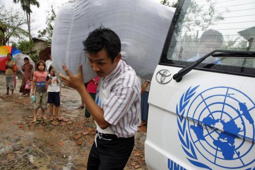 A UNHCR aid worker delivering supplies in the aftermath of Cyclone Nargis in Myanmar. By United Nations photo.