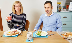 Helen and Yasser eat their separate breakfasts. Photograph: Christopher Thomond for the Guardian