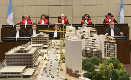 Judges at the Special Tribunal for Lebanon look over a model of the area of Beirut where former Prime Minister Rafiq Hariri was assassinated (Photo: STL)